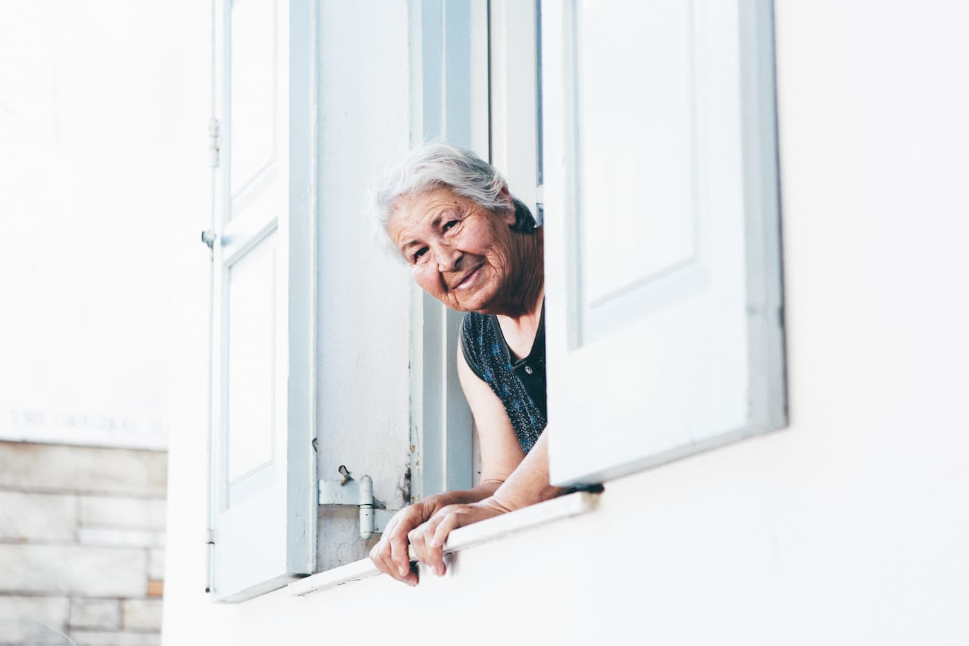 Active older women looking out a window