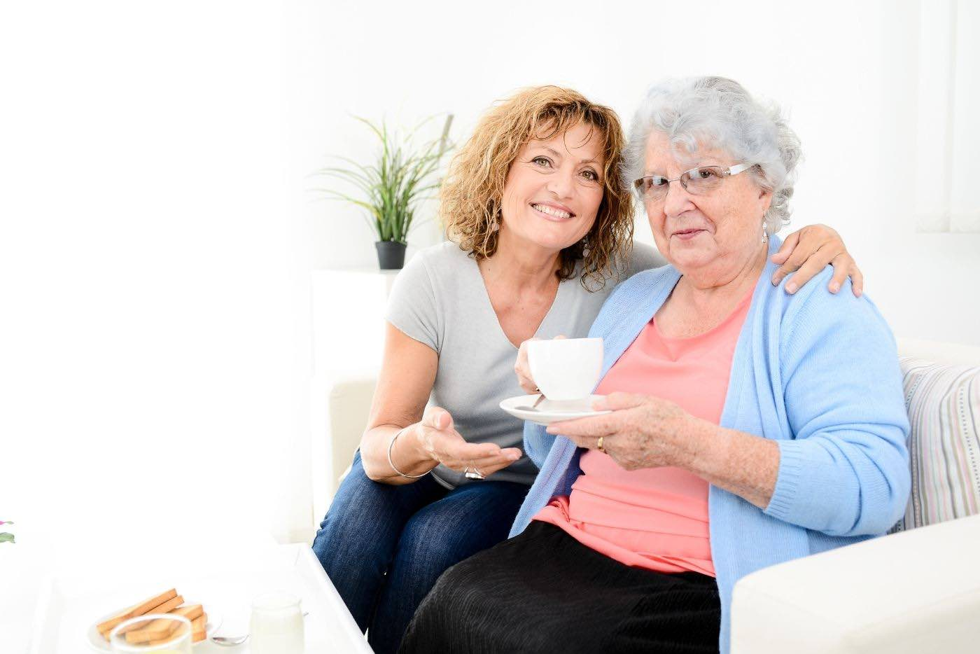 Live-In Caregivers with Senior Woman