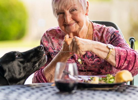 A senior women with her pet dog
